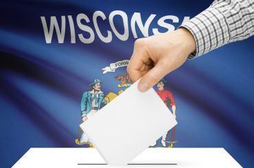 Voting concept - Ballot box with national flag on background - Wisconsin