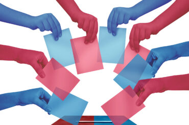 Election day vote and voting concept casting red and blue ballots at a polling station as a democratic right in a democracy as diverse hands holding votes with 3D illustration elements.